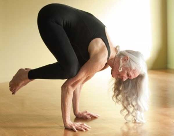 Fighting the myths of aging-older woman in crow pose