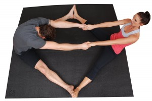 partnered yoga on square mat