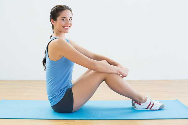 wearing shoes in yoga- woman sitting on yoga mat