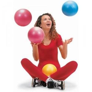woman juggling gymnic overball
