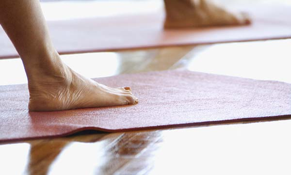 Yoga mat cleaners- feet on yoga mat