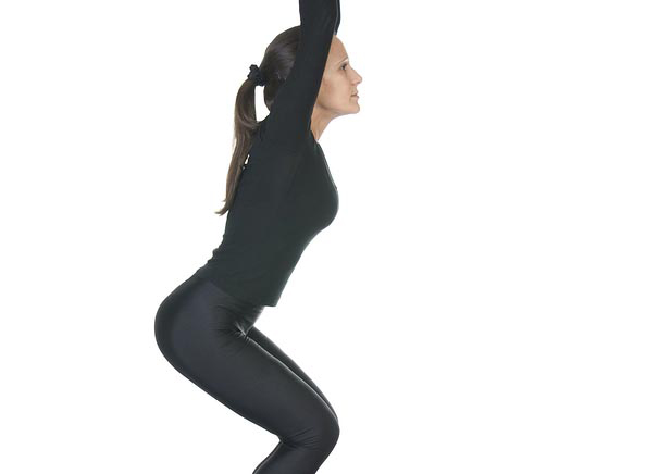 Yoga pose Utkatasana or chair position