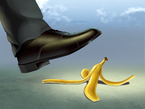 Businessman about to slip on a banana peel.